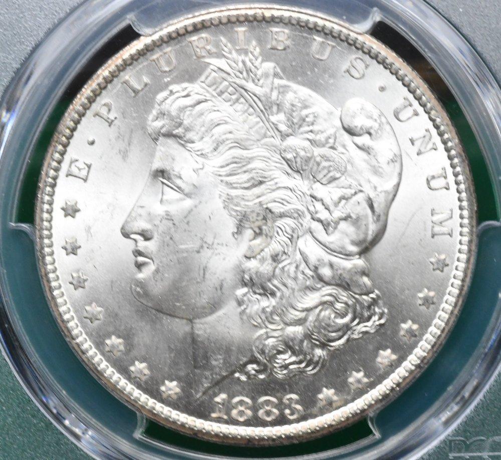 1883 CC Morgan Dollar PCGS for sale.
